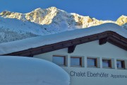 chalet hinteransicht ortler winter
